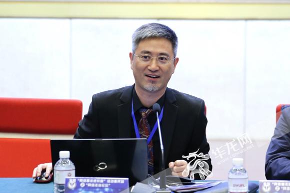 01  重庆大学网络与大数据法治战略研究院院长齐爱民。记者 石涛 摄.jpg